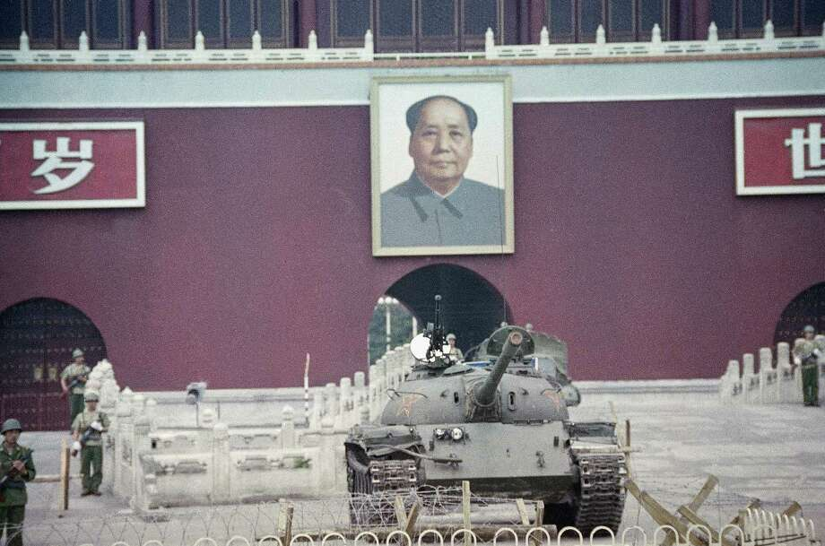 A Peoples Liberation Army tank sits below the portrait of Chairman Mao at the Gate of Heavenly Peace, Sunday, June 11, 1989, Beijing, China. Photo: Sadayuki Mikami, AP / 1989 AP