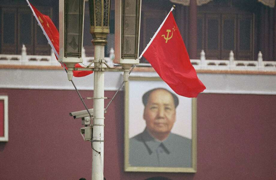 The Soviet flag frames the portrait of Mao Tse-tung in Beijing?s Tiananmen Square as President Mikhail Gorbachev arrived in the Chinese capital of Beijing on Monday, May 15, 1989. It is the first sino-Soviet summit since Mao gave Nikita Khrushchev the cold shoulder in Beijing in 1959. Photo: Sadayuki Mikami, ASSOCIATED PRESS / AP1989