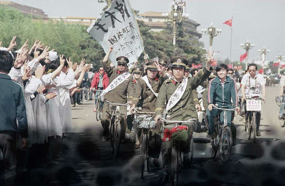Beijing police parade through Tiananmen Square carrying banners in support of striking University students, Friday, May 19, 1989, Beijing, China.  The students are in the sixth day of their hunger strike for political reform. Photo: Sadayuki Mikami, AP / 1989 AP