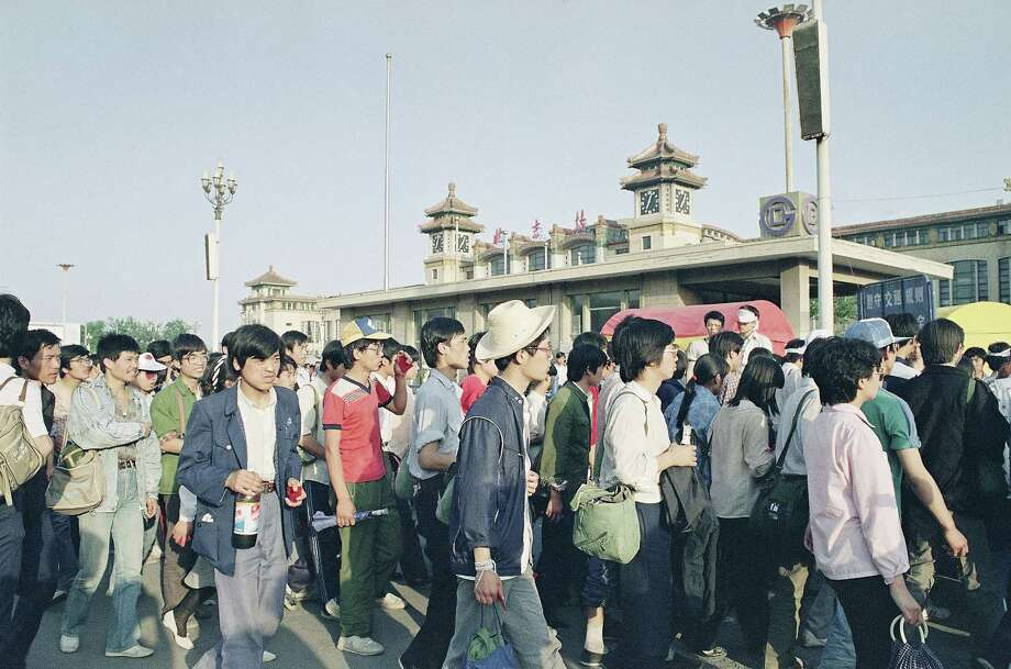 Students line up at the Beijing railroad station, May 26, 1989 as they depart for their home provinces. Several thousand left the capital by evening. Photo: Mark Avery, AP / 1989 AP
