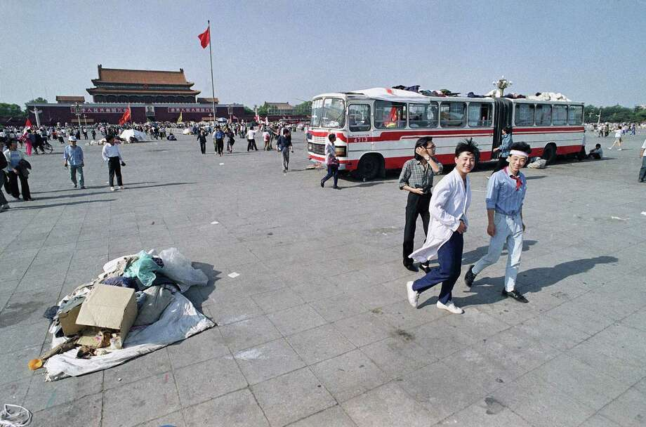 More than 80 city buses that were provided as shelter for striking students have been removed from Beijing's Tiananmen Square, Friday, May 26, 1989 in Beijing. The one remaining bus is being used as a clinic. Photo: Mark Avery, AP / 1989 AP