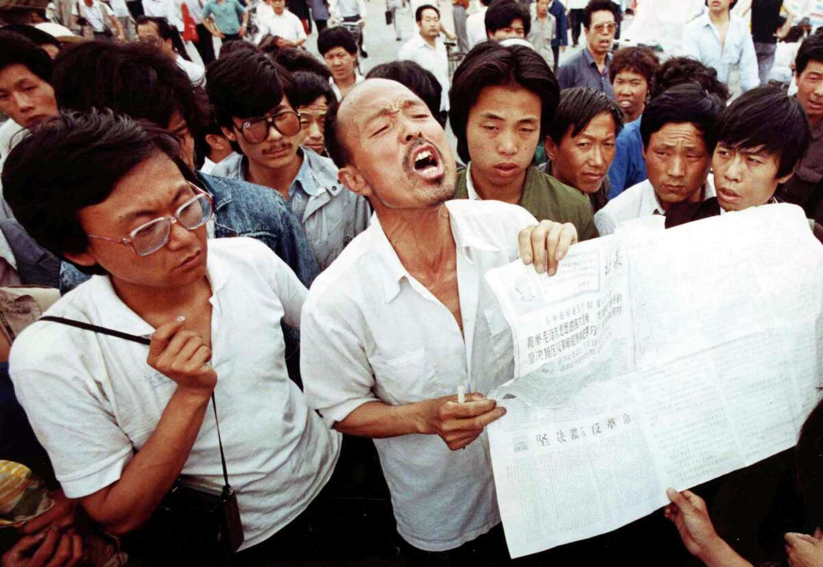 A man who identified himself as a former political prisoner relates his experiences to striking students in Tiananmen Square, Beijing, on May 28, 1989. Students have held the square in a democracy demonstration for more than two weeks.