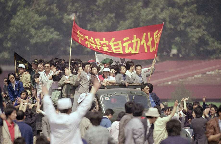 Beijing University students rally in Tiananmen Square where they have camped for a week to push for political reforms, Saturday, May 20, 1989, Beijing, China. The government declared martial law on Saturday in an effort to end the occupation. Photo: Sadayuki Mikami, ASSOCIATED PRESS / AP1989