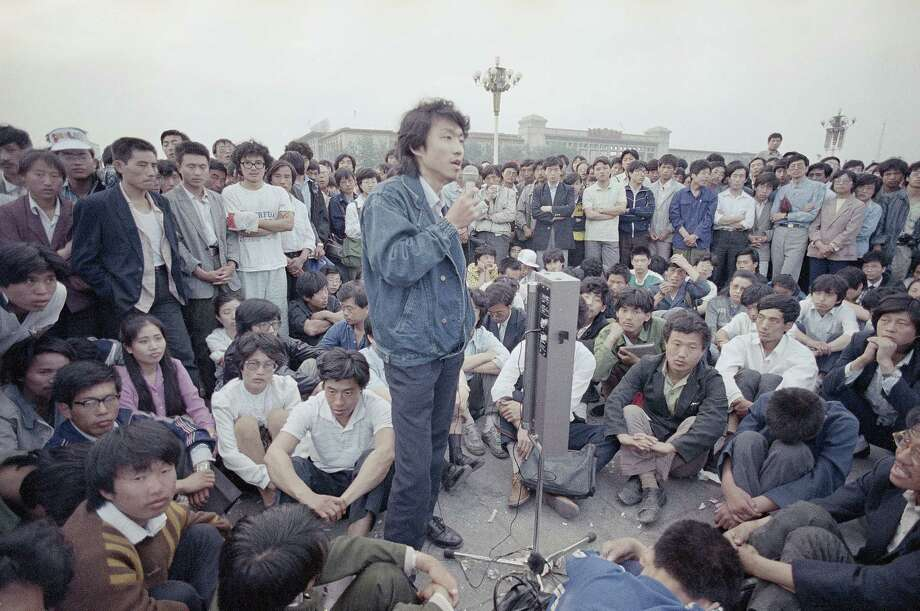 Beijing University students listen as an unidentified strike spokesman details plans for a rally in Tiananmen Square on May 28, 1989, Beijing, China. Photo: Jeff Widener, AP / 1989 AP