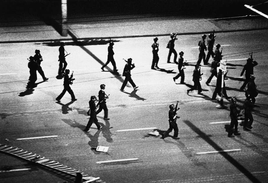 A ceremony of PIA troops march down Chanan Blvd. firing indiscriminately to clear the street of citizens as the army faction occupying the center of Beijing prepares for the rumored arrival of opposition troops converging on the city, June 5, 1989, Beijing, China. Photo: Anonymous, ASSOCIATED PRESS / AP1989