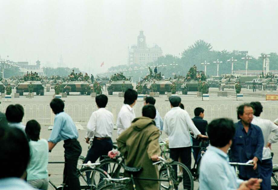 Crowds of curious Beijing residents gather to look at the military hardware in Tiananmen Square Wednesday, June 7, 1989 in Beijing. Photo: Sadayuki Mikami, AP / 1989 AP