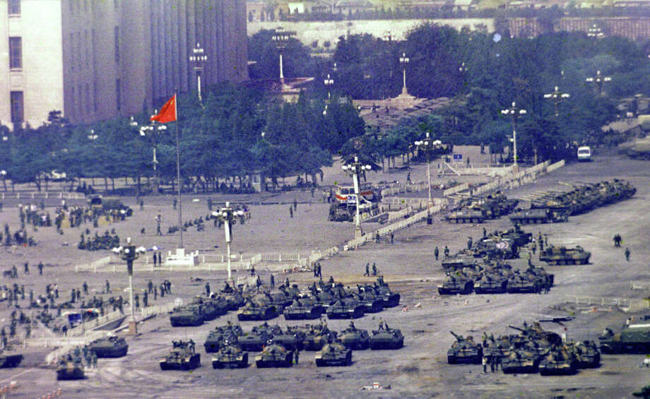 Chinese troops and tanks gather in Beijing, June 5, 1989, one day after the military crackdown that ended a seven week pro-democracy demonstration on Tiananmen Square. Hundreds were killed in the early morning hours of June 4. Photo: Jeff Widener, ASSOCIATED PRESS / AP1989