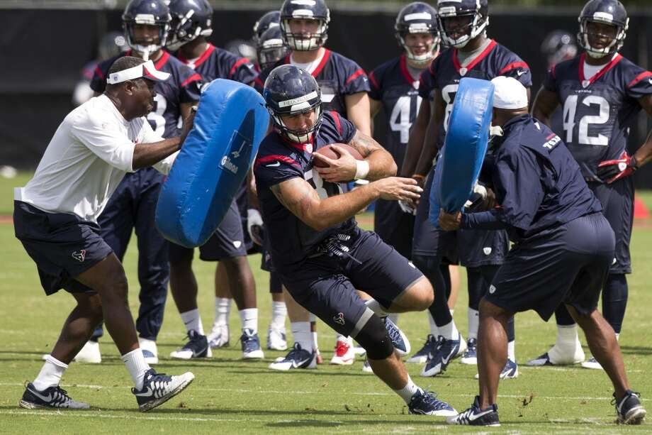 Texans tight end C.J. Fiedorowicz runs between a pair of blocking pads after making a catch. Photo: Brett Coomer, Houston Chronicle