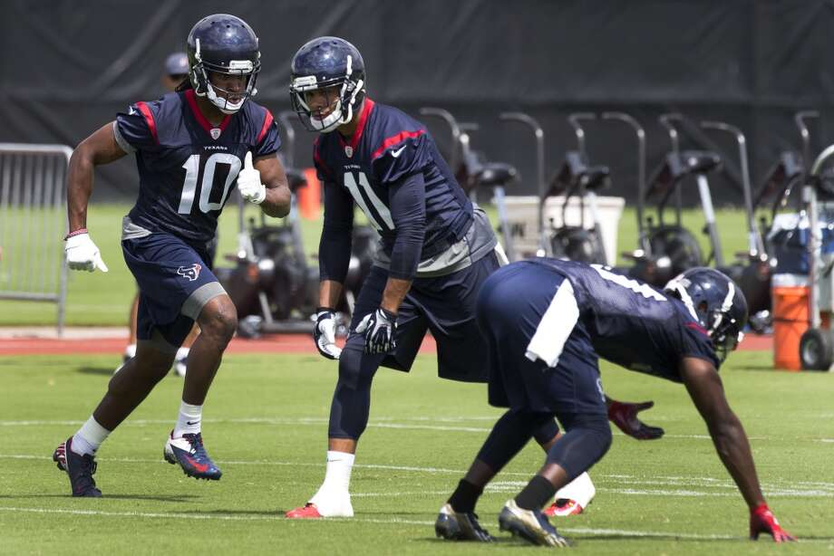 Texans wide receiver DeAndre Hopkins (10) and DeVier Posey (11) run a drill. Photo: Brett Coomer, Houston Chronicle