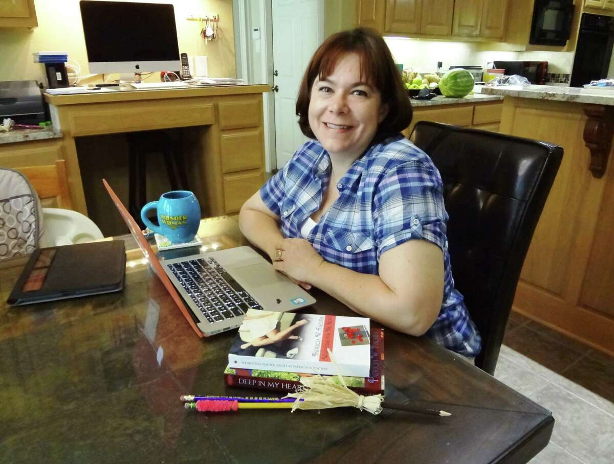 San Antonio romance author Patricia Fischer writers her R-rated tales at her kitchen table in her north San Antonio home.