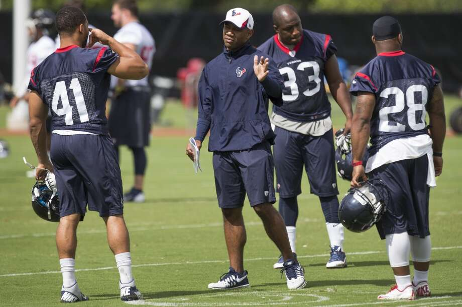 Texans running backs coach Charles London, center, works with running backs Jonathan Grimes (41), Andre Brown (33) and Dennis Johnson (28). Photo: Brett Coomer, Houston Chronicle