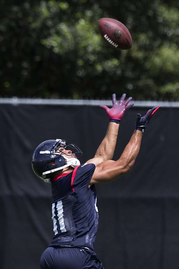 Texans running back Jonathan Grimes reaches out to make a catch. Photo: Brett Coomer, Houston Chronicle