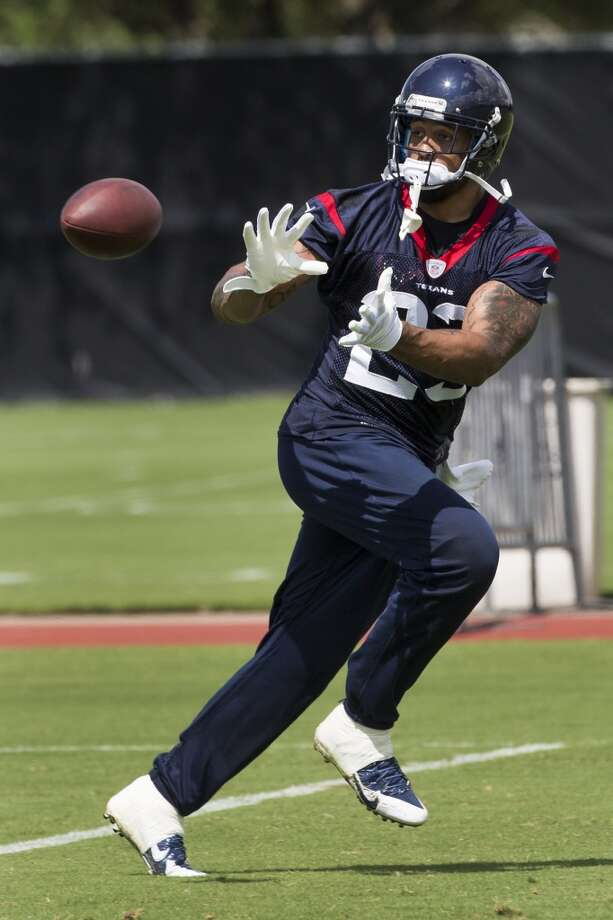 Texans running back Arian Foster reaches out to make a catch. Photo: Brett Coomer, Houston Chronicle