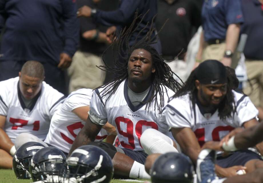 Day 4 - June 2  Jadeveon Clowney (90) stretches before practice. Photo: J. Patric Schneider, For The Chronicle
