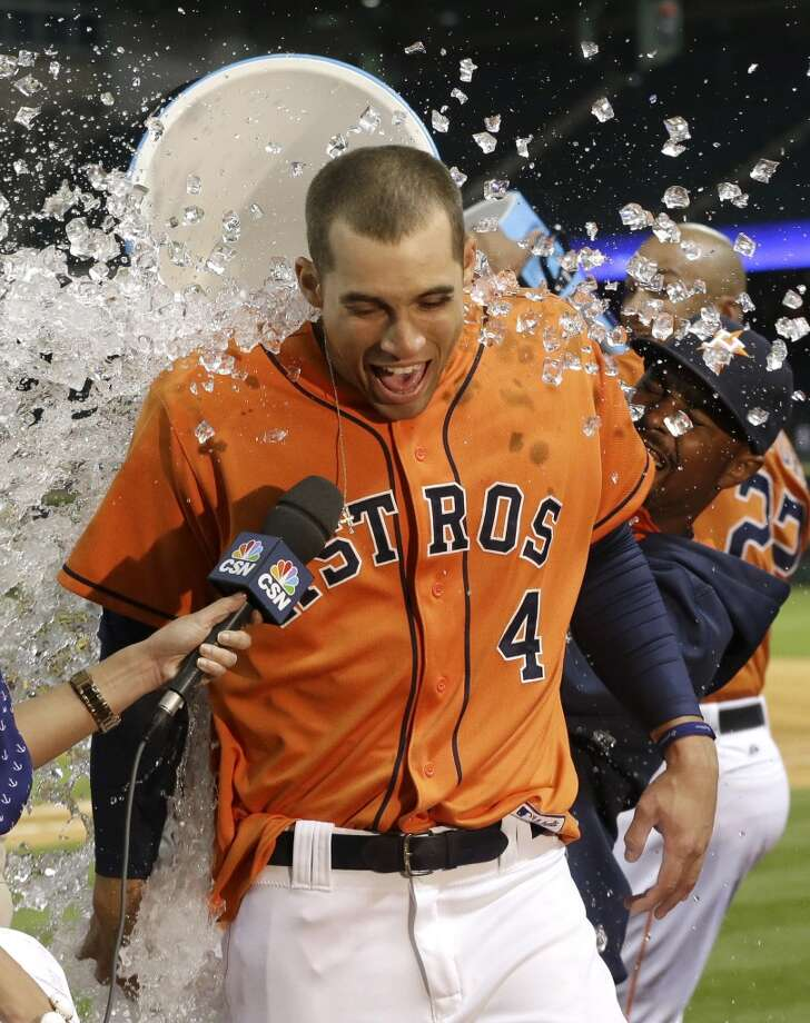 George Springer is doused with ice water after hitting the game-winning RBI single in the 11th inning on May 2, 2014. Photo: Pat Sullivan, Associated Press
