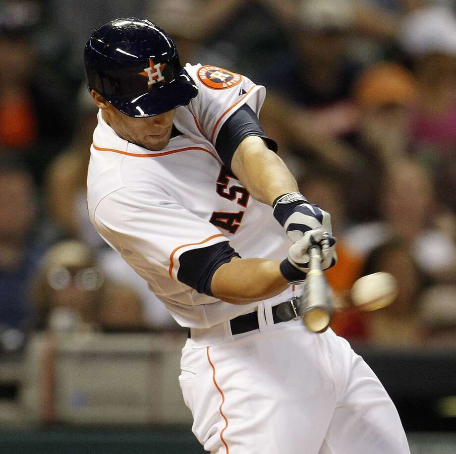 George Springer hits a an RBI single in the third inning on April 29, 2014. Photo: Karen Warren, Houston Chronicle