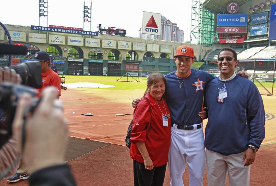 George Springer poses with his parents Laura Springer and George Springer II before his first MLB game. Photo: Melissa Phillip, Houston Chronicle