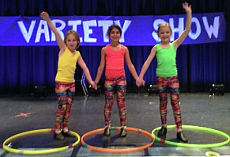 Kings Highway Elementary School first graders performed at the school's variety show.  From left: Brooke Saporta, Samantha Henske and Charlotte Seymour. Photo: Contributed Photo / Westport News