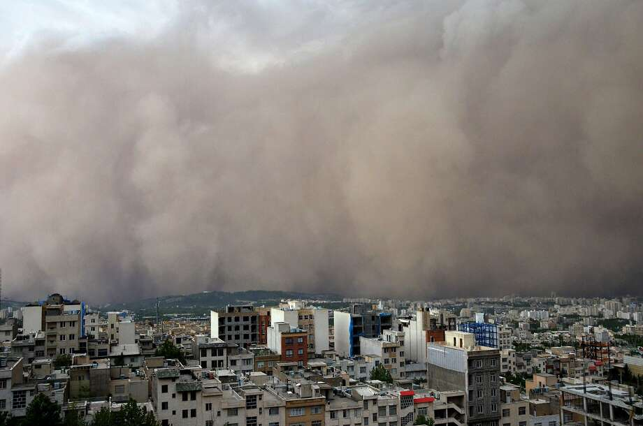 A massive sandstorm, accompanied by record   winds, engulfs the northeastern section of Tehran. The storm was blamed for at least four deaths, as well as power outages, damaged buildings and widespread transit disruption. Photo: Saeedeh Eslamieh, AFP/Getty Images