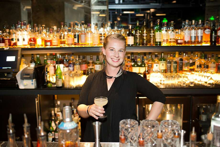 Caley Shoemaker, new head distiller at Hangar 1 Vodka, orders a Going Rogue from bartender Max Alexander during the San Francisco Chronicle's Top 100 party at Dirty Habit in San Francisco, Calif., Monday, June 2, 2014. Photo: Jason Henry, Special To The Chronicle