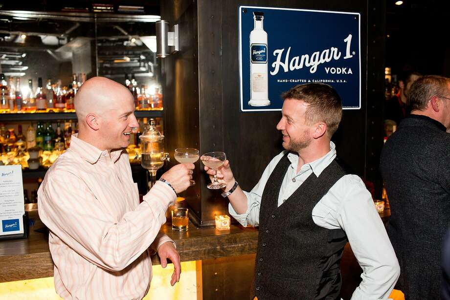Christian Albertson and Nat Cutler, of Monks Kettle and Abbots Cellar, cheers with Hangar 1 signature cocktails during the San Francisco Chronicle's Top 100 party in San Francisco, Calif., Monday, June 2, 2014. Photo: Jason Henry, Special To The Chronicle