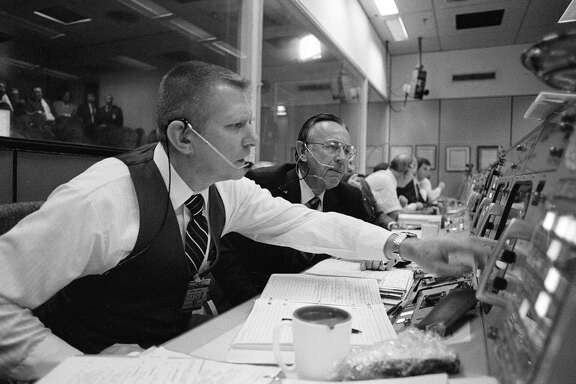 Deputy director Gene Kranz, left, and director Chris Kraft monitor data from a space shuttle launch at Johnson Space Center. It's been almost three years since the shuttle program ended, leaving NASA without a reusable launch system.