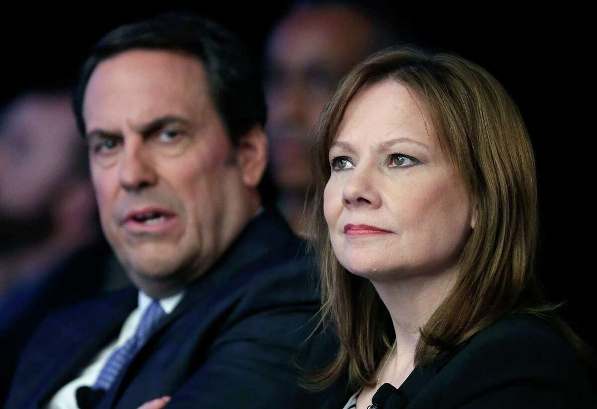 FILE - In this April 15, 2014 file photo, Mary Barra, CEO of General Motors, right, and Mark Reuss, Executive Vice President of Global Product Development for GM and President of GM America, watch the introduction of new Chevrolet cars at the New York International Auto Show, in New York. GM's corporate structure _ as well as what Barra has called a culture that valued cost-savings over safety _ will likely be a prime target in a report expected this week from former U.S. Attorney Anton Valukas. (AP Photo/Mark Lennihan, File) ORG XMIT: NYBZ103