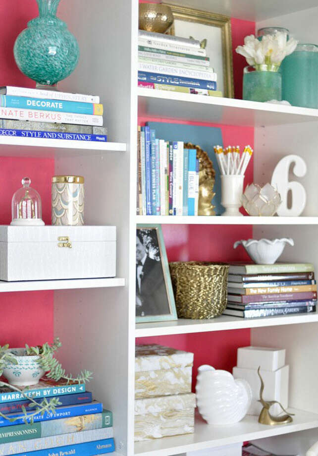 Re-merch your shelvesYour shelves should be practical, but why not make them beautiful, too? Take inspiration from blogger Centsational Girl and consider arranging books by color, stacking them both vertically and laying them horizontally, and unless you adhere to the books-only-on-the-bookshelf rule, nestle in some trinkets. Add a small, framed picture in front of a few volumes, a favorite memento on top of one of the piles, or a box for hiding unsightly odds and ends. Use the moment to weed out old stuff-nothing feels better than donating those old travel books you've had hanging around for way too long.Top Places To Score Decor DealsPaint Colors To Transform Every RoomJazz Up Your Home Office9 Cheap And Cheerful Home IdeasPicture Yourself In These Living RoomsTime To Upgrade Your Home Bar Photo: Kate Riley