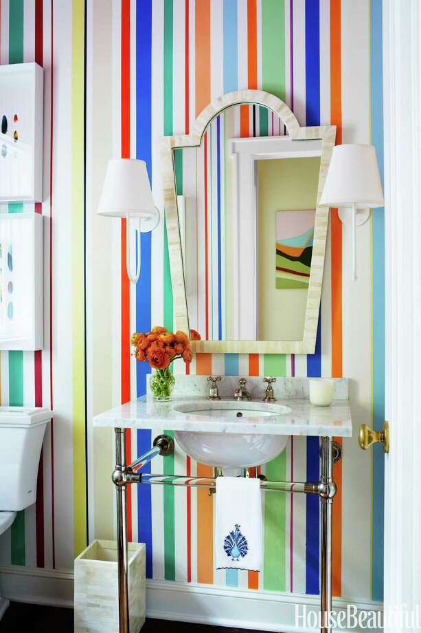 Hand-Painted DesignThe powder room's hand-painted stripes by Deirdre Newman combine colors used throughout Rye, New York, Tudor house designed by Sara Gilbane. Sink by Waterworks.The Best Bathroom DesignsHow To Create An At-Home Getaway12 Best Paint Colors For Your FoyerOrganizing Tips For Every RoomThe Bathroom Renovation ChecklistThe Colors That Will Define The Year Ahead Photo: Francesco Lagnese / @Copyright Francesco Lagnese 2013