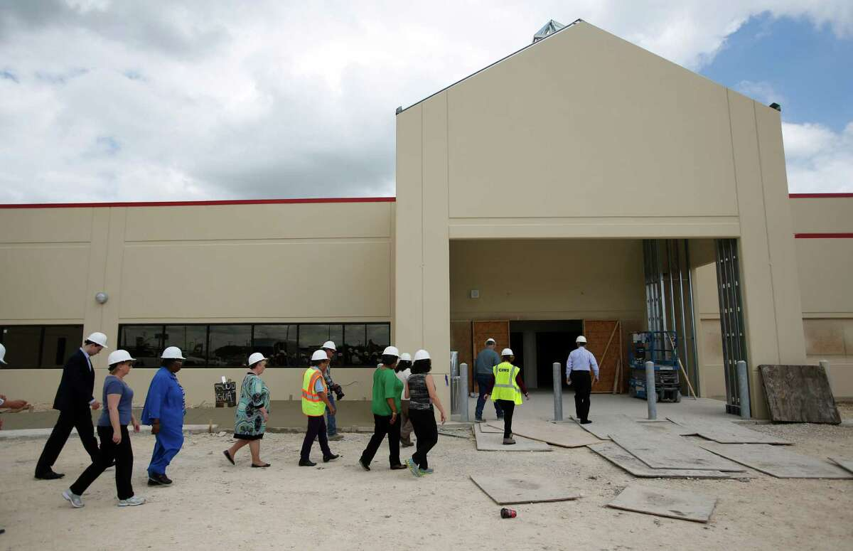 City of San Antonio staff and officials and Pre-K 4 SA board members tour the still-under construction West Side Pre-K 4 SA facility Tuesday, June 3, 2014.