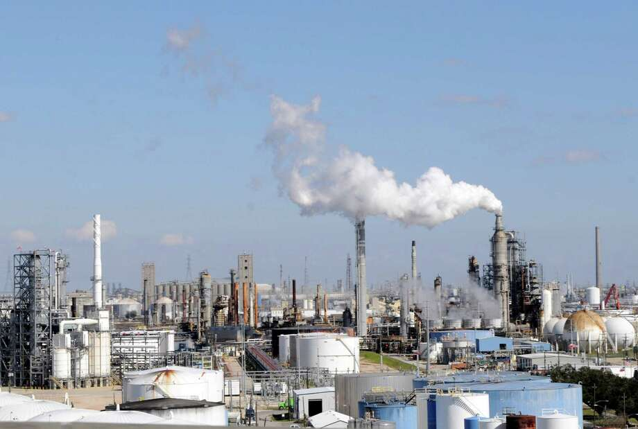 In this Feb. 25, 2010 file photo, a sea of stacks, pipes and storage tanks are amassed along the Houston ship channel in Houston.  (AP Photo/Pat Sullivan, File) Photo: Pat Sullivan, STF / AP