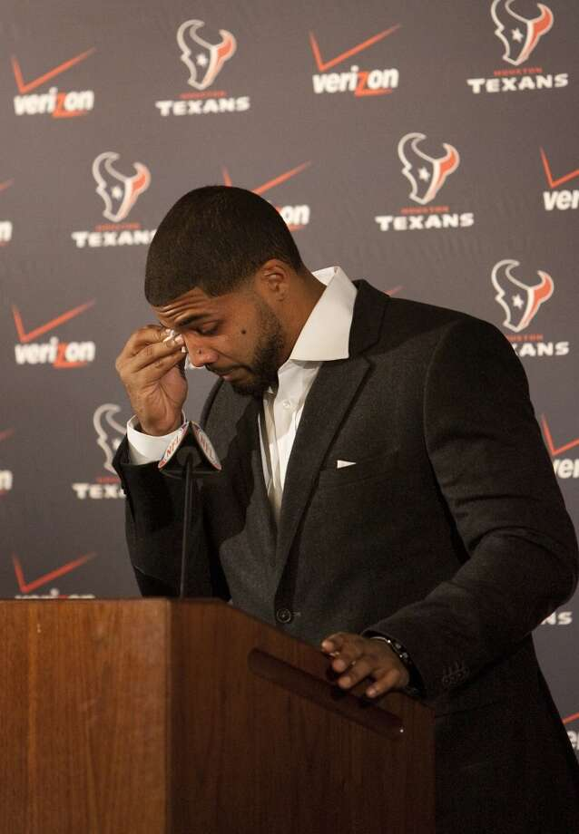 Arian Foster wipes tears from his eyes during a news conference at Reliant Stadium announcing his $43.5 million, five-year deal with the Texans. Photo: Cody Duty, Houston Chronicle