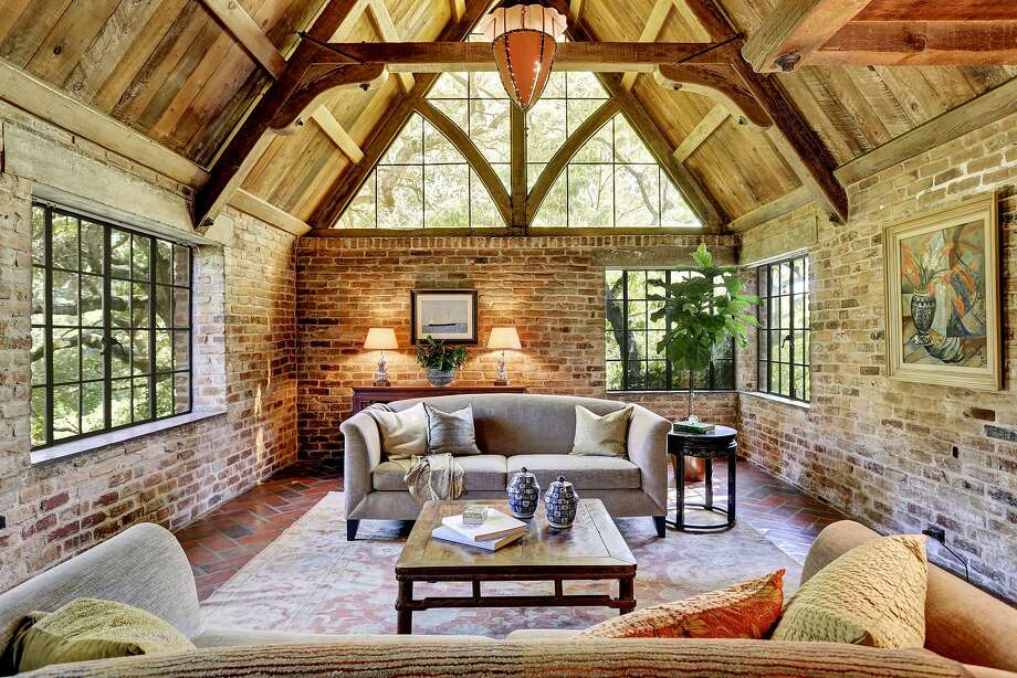 The home features a storybook style, brick arches and rough-hewn wood.  Photo: Liz Rusby/The Grubb Co.