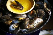 Iron-skillet roasted mussels made at LuLu's in San Francisco, Calif., Tuesday, December 14, 2010. It has been on Lulu's menu since 15 years ago.