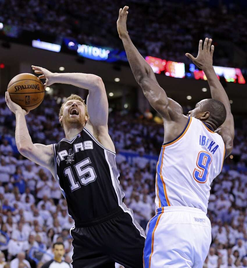 San Antonio Spurs' Matt Bonner shoots around Oklahoma City Thunder's Serge Ibaka during first half action in Game 6 of the Western Conference finals Saturday May 31, 2014 at Chesapeake Energy Arena in Oklahoma City, OK. Photo: Edward A. Ornelas, San Antonio Express-News
