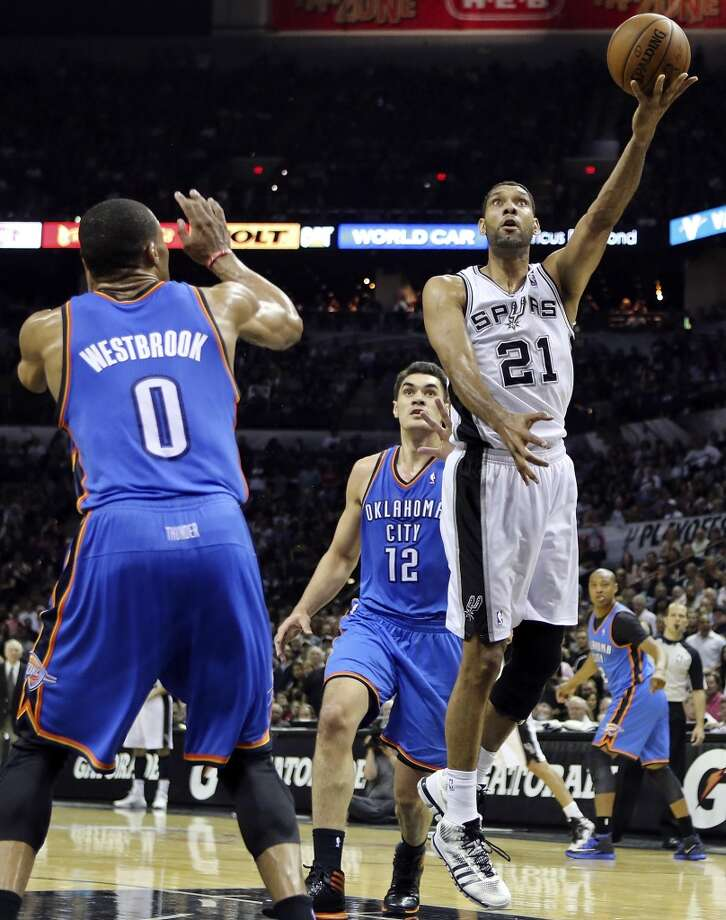 San Antonio Spurs' Tim Duncan shoots between Oklahoma City Thunder's Russell Westbrook and Oklahoma City Thunder's Steven Adams during second half action in Game 5 of the Western Conference finals Thursday May 29, 2014 at the AT&T Center. The Spurs won 117-89. Photo: Edward A. Ornelas, San Antonio Express-News