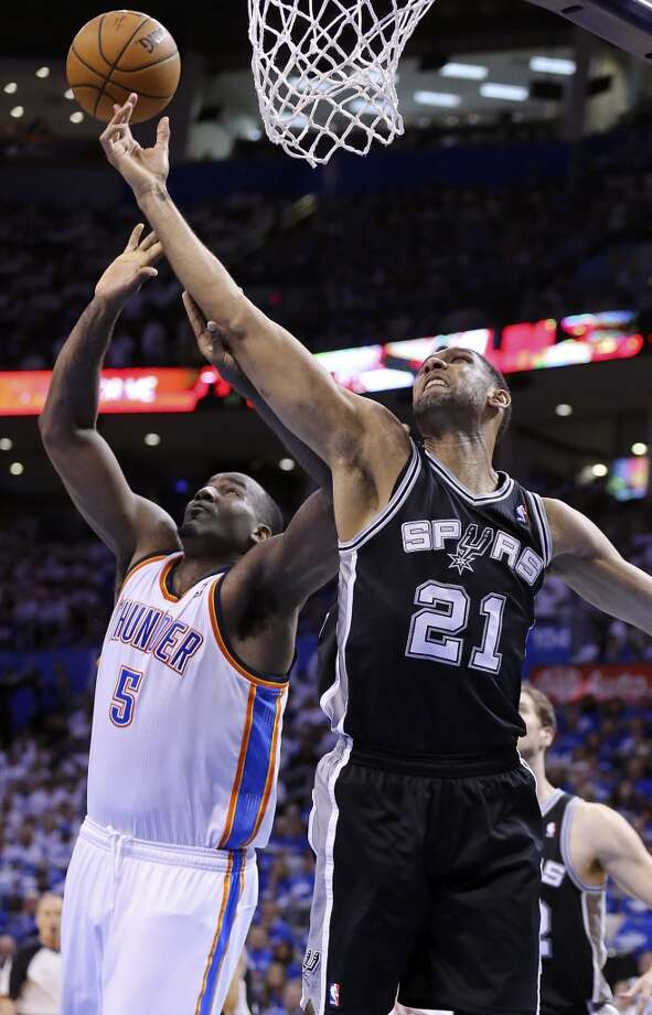 Oklahoma City Thunder's Kendrick Perkins and San Antonio Spurs' Tim Duncan grab for a rebound during second half action in Game 4 of the Western Conference Finals Tuesday May 27, 2014 at Chesapeake Energy Arena in Oklahoma City, OK. Photo: Edward A. Ornelas, San Antonio Express-News