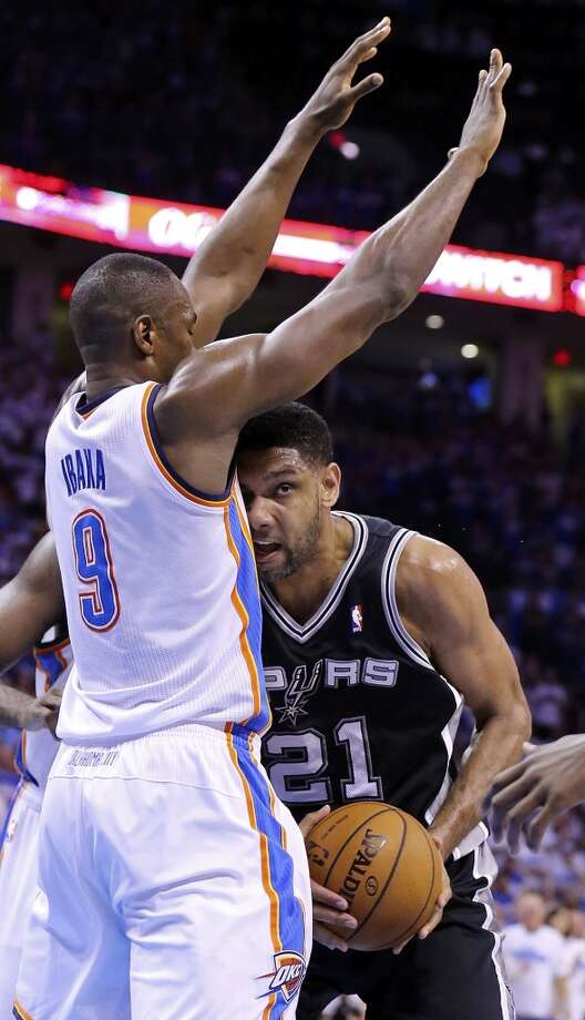 Oklahoma City Thunder's Serge Ibaka defends San Antonio Spurs' Tim Duncan during first half action in Game 4 of the Western Conference Finals Tuesday May 27, 2014 at Chesapeake Energy Arena in Oklahoma City, OK. Photo: Edward A. Ornelas, San Antonio Express-News