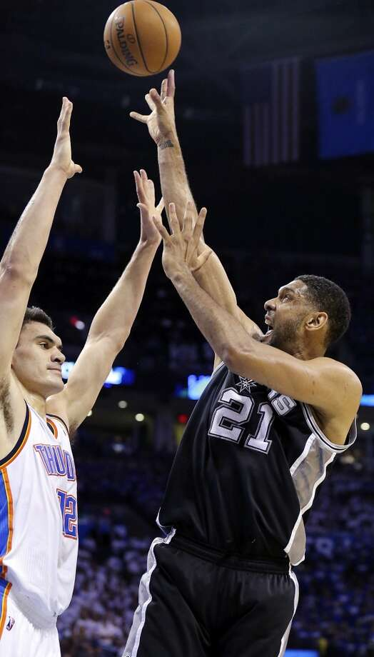 San Antonio Spurs' Tim Duncan shoots over Oklahoma City Thunder's Steven Adams during first half action in Game 4 of the Western Conference Finals Tuesday May 27, 2014 at Chesapeake Energy Arena in Oklahoma City, OK. Photo: Edward A. Ornelas, San Antonio Express-News