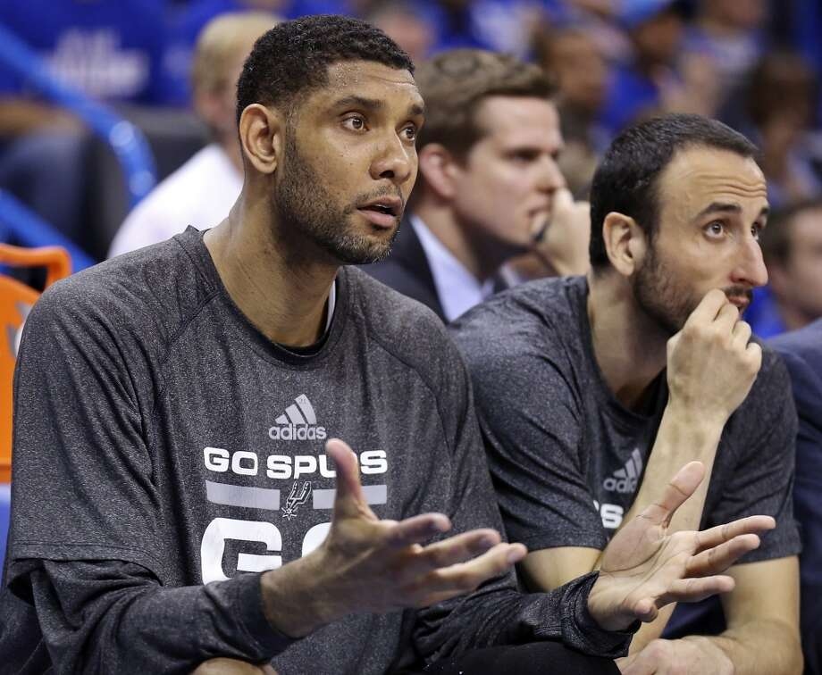 San Antonio Spurs' Tim Duncan, and Manu Ginobili watch second half action in Game 4 of the Western Conference Finals against the Oklahoma City Thunder from the bench Tuesday May 27, 2014 at Chesapeake Energy Arena in Oklahoma City, OK. Photo: Edward A. Ornelas, San Antonio Express-News