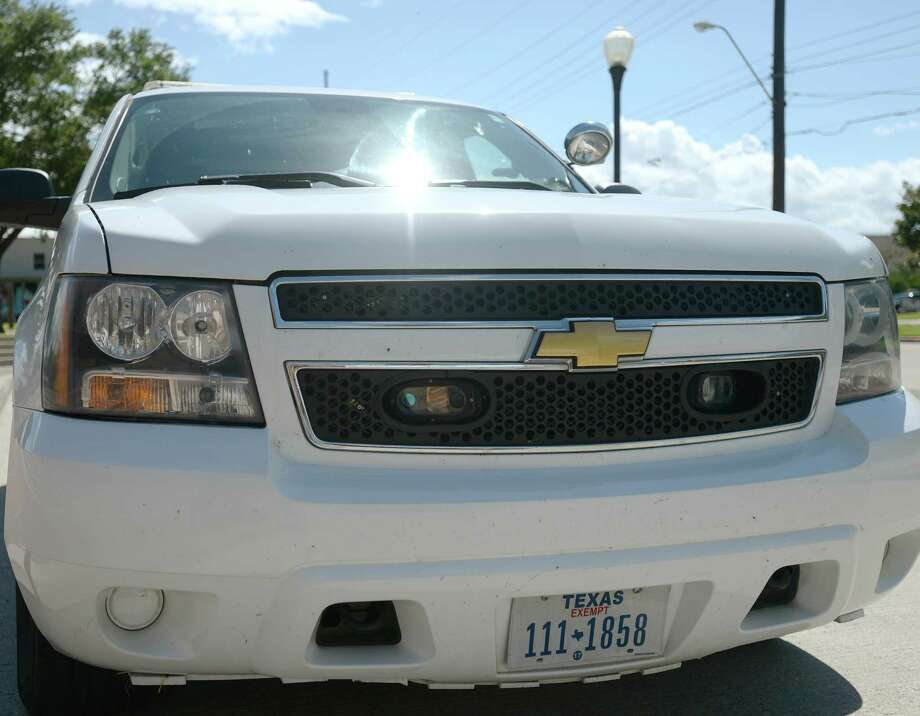 The Beaumont Police Department Tahoe driven by Officer Aaron Wasser has three cameras attached -- two in the front grill and one in the rear driver-side bumper. The Beaumont City Council is purchasing a new license plate reader for the police department. The department already has three of the devices, which automatically reads plate numbers and looks for matches in law enforcement databases.  Photo taken Tuesday 6/3/14 Jake Daniels/@JakeD_in_SETX Photo: Jake Daniels / ©2014 The Beaumont Enterprise/Jake Daniels