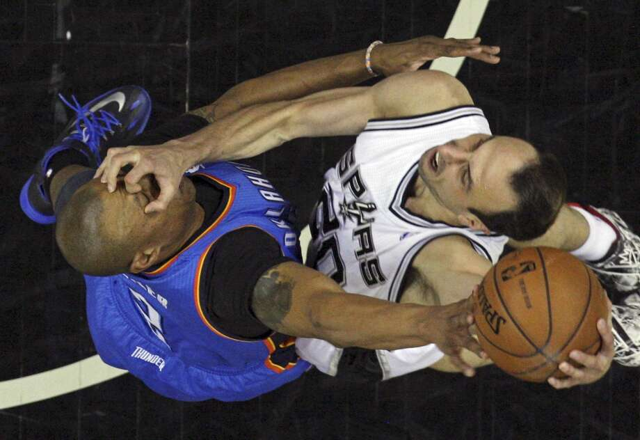 San Antonio Spurs' Manu Ginobili shoot against Oklahoma City Thunder's Caron Butler during Game 5 of the Western Conference finals Thursday May 29, 2014 at the AT&T Center. The Spurs won 117-89. Photo: Edward A. Ornelas, San Antonio Express-News