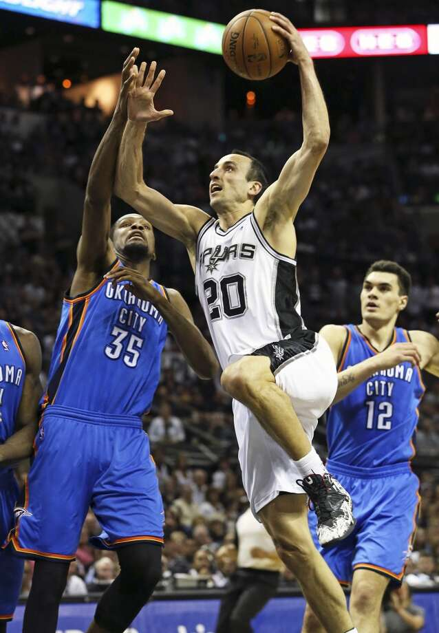 Manu Ginobili rolls a shot in on Kevin Durant as the Spurs play the fifth game of the Western Conference Finals against the Oklahoma City Thunder on May 29, 2014. Photo: Tom Reel, San Antonio Express-News