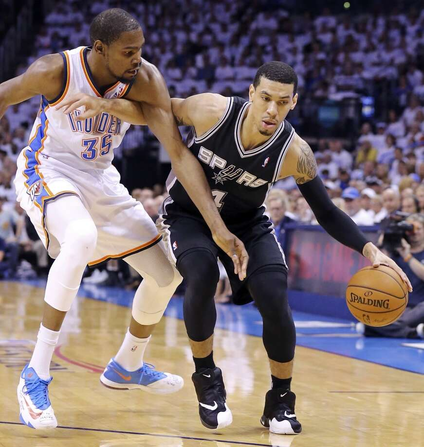 San Antonio Spurs' Danny Green looks for room around Oklahoma City Thunder's Kevin Durant during first half action in Game 6 of the Western Conference finals Saturday May 31, 2014 at Chesapeake Energy Arena in Oklahoma City, OK. Photo: Edward A. Ornelas, San Antonio Express-News
