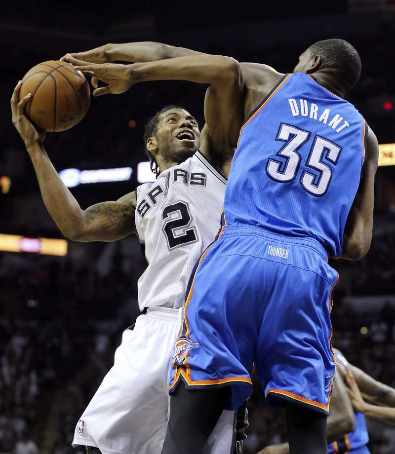 San Antonio Spurs' Kawhi Leonard looks for room around Oklahoma City Thunder's Kevin Durant during Game 5 of the Western Conference finals Thursday May 29, 2014 at the AT&T Center. The Spurs won 117-89. Photo: Edward A. Ornelas, San Antonio Express-News