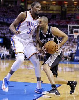 San Antonio Spurs' Tony Parker looks for room around Oklahoma City Thunder's Kevin Durant during first half action in Game 6 of the Western Conference finals Saturday May 31, 2014 at Chesapeake Energy Arena in Oklahoma City, OK. Photo: Edward A. Ornelas, San Antonio Express-News