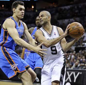 Oklahoma City Thunder's Steven Adams defends San Antonio Spurs' Tony Parker during Game 5 of the Western Conference finals Thursday May 29, 2014 at the AT&T Center. The Spurs won 117-89. Photo: Edward A. Ornelas, San Antonio Express-News
