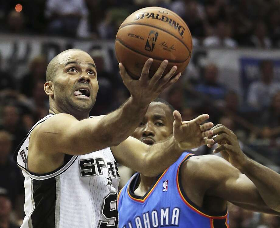 Tony Parker beats Serge Ibaka to the hoop as the Spurs play the fifth game of the Western Conference Finals against the Oklahoma City Thunder on May 29, 2014. Photo: Tom Reel, San Antonio Express-News