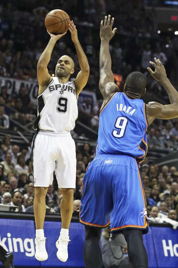 Tony Parker opens the game up with a shot over Serge Ibaka in the second quarter as  the Spurs play the fifth game of the Western Conference Finals against the Oklahoma City Thunder on May 29, 2014. Photo: Tom Reel, San Antonio Express-News