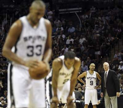 San Antonio Spurs' Tony Parker talks with head coach Gregg Popovich during Game 5 of the Western Conference finals against the Oklahoma City Thunder Thursday May 29, 2014 at the AT&T Center. The Spurs won 117-89. Photo: Edward A. Ornelas, San Antonio Express-News